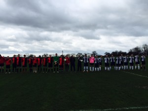 The two teams lined up before the customary handshakes.